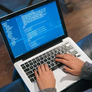 hands-typing-code-on-laptop